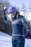 Woman throwing snowball. Happy mid-adult woman  throwing snowball Royalty Free Stock Photography