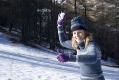 Woman throwing snowball Stock Photos