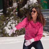 Woman throwing snowball Stock Images