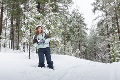 Woman throwing snowball outdoors winter Royalty Free Stock Image