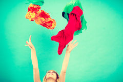 Woman throwing up clothes, clothing flying everywhere Royalty Free Stock Photos