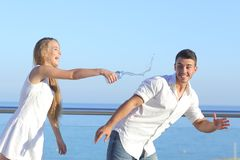 Woman throwing water to her boyfriend Stock Photography