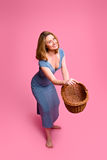 Woman throwing wicker basket stock image