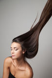 Woman thrown up her hair Royalty Free Stock Photo