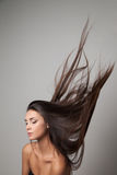 Woman thrown up her hair Stock Photography