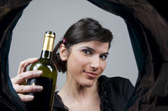 Woman throws a glass bottle Royalty Free Stock Photography