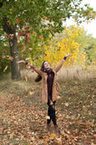 Woman throws with leaves Royalty Free Stock Photo