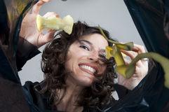 Woman throws organic waste materials in the garbag Stock Photography
