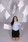Woman throws out paper into the air Royalty Free Stock Image