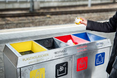 Woman throws paper trash in the trash sorting waste Stock Image