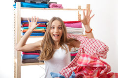 Woman throws a pile of clothes, isolated on white Royalty Free Stock Image