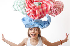 Woman throws a pile of clothes, isolated on white Stock Images