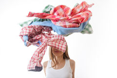 Woman throws a pile of clothes, isolated on white Stock Photography
