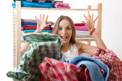 Woman throws a pile of clothes, isolated on white Stock Photo
