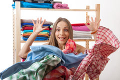 Woman throws a pile of clothes, isolated on white Stock Image