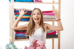 Woman throws a pile of clothes, isolated on white Royalty Free Stock Images