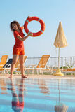 Woman Throws Red Buoy Ring To Pool Royalty Free Stock Images