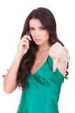 Woman with thumb down gesture on phone Royalty Free Stock Photography