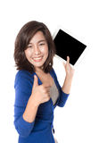 Woman thumb up with digital tablet on white background. Stock Images