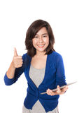 Woman thumb up with digital tablet on white background. Stock Image