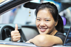 Woman thumb up in her car Stock Image