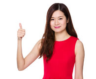 Woman with thumb up. Isolated on white background Stock Photography