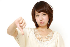 Woman with thumbs down gesture Royalty Free Stock Photos
