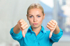Woman with thumbs down Royalty Free Stock Images