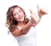 Woman with thumbs up. Pretty happy young woman with her thumbs up, isolated against white background Royalty Free Stock Images
