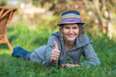 Woman with thumbs up gesture Royalty Free Stock Image