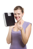 Woman with thumbs up holding a weight scale stock images