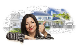 Woman with Thumbs Up Over House Drawing and Photo stock photography