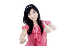 Woman with thumbs up in studio Royalty Free Stock Image