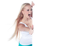Woman with thumbs up and white panel Stock Image