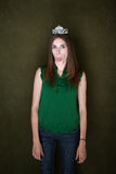 Woman With Tiara Sticks Out Her Tongue Stock Images