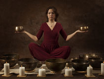 Woman with Tibetan bowls in her hands Stock Photos