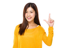 Woman with tick sign Stock Images