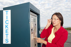 Woman at ticket machine Stock Images