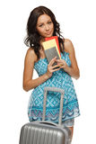 Woman with tickets and suitcase. Young female in casual standing with travel bag, holding passport and tickets,isolated on withe background Stock Photos