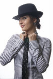 Woman with tie and hat Royalty Free Stock Photos