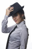 Woman with tie and hat Stock Photography