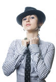 Woman with tie and hat Stock Photos