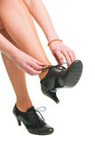 Woman tie her shoes Stock Photography