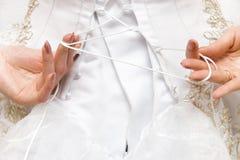 Woman tie her wedding dress Royalty Free Stock Photo