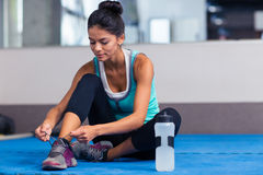 Woman tie shoelaces in gym Stock Photo
