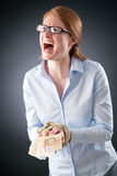 Woman with Tied Hands and Cash Screaming. A young businesswoman wearing glasses holding a lot of Euros in her hands tied with a rope, screaming for help Stock Images