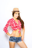 Woman in tied shirt, shorts and hat Royalty Free Stock Photo