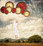 Woman tied to clocks floating away royalty free stock photos