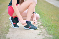 Woman tieing shoe Stock Photography