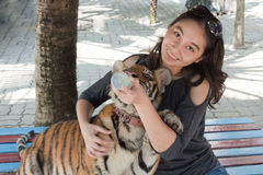 Woman and tiger Royalty Free Stock Image